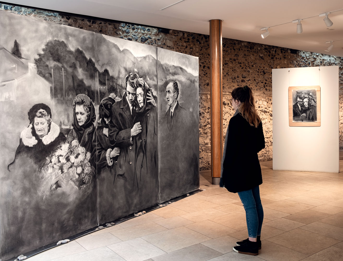 A visitor looks at the large drawing made by artist James Kessell at Norwich Cathedral